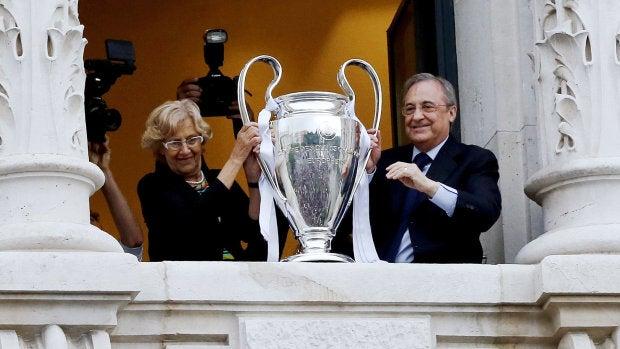 Florentino Pérez junto a Manuela Carmena y la Champions