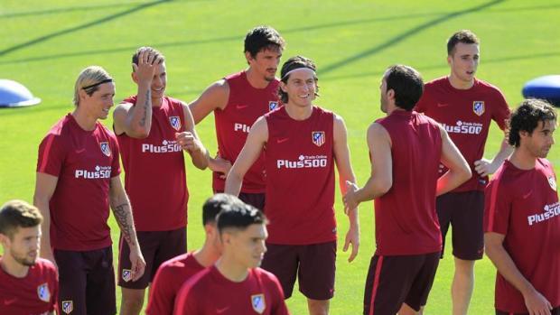 Los jugadores del Atlético, en la sesión de entrenamiento.