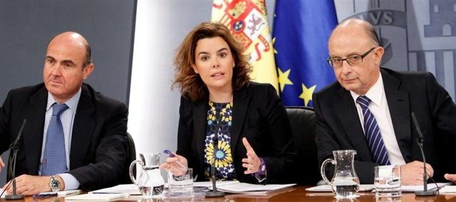 Guindos, Montoro y Santamaría en rueda de prensa