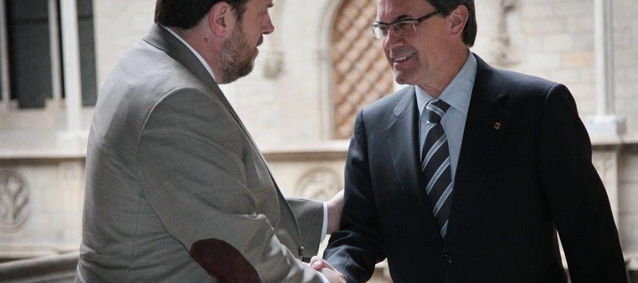 Mas y Junqueras pactan celebrar una consulta de autodeterminación en 2014