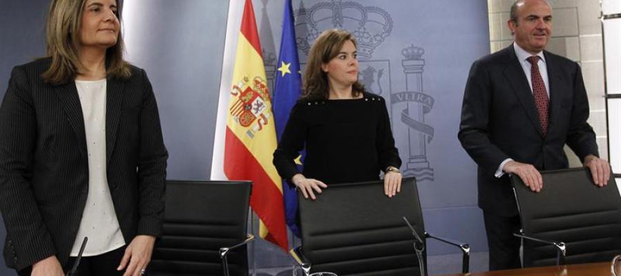Fátima Báñez, Soraya Sánez de Santamaría y Luis de Guindos