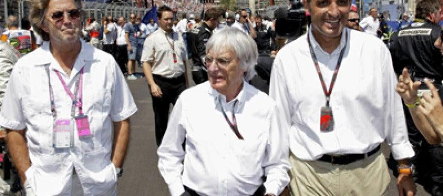 Francisco Camps junto al patrón de la Fórmula Uno, Bernie Ecclestone y el músico Eric Clapton