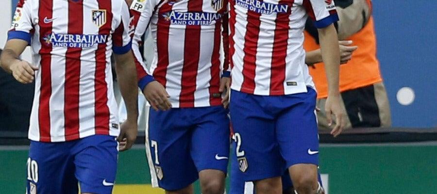 Griezmann y Diego Godín Griezmann y Diego Godín celebran un golcelebran un gol ante el Levante.