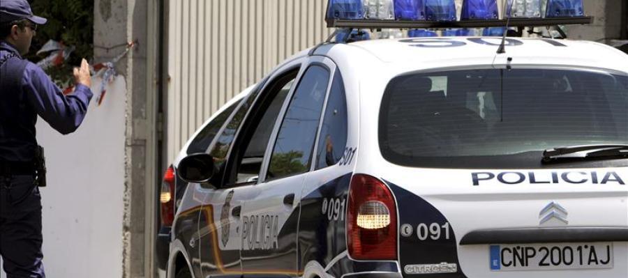 Un coche de la Policía en un suceso