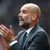 Guardiola anima a sus jugadores durante un partido del City