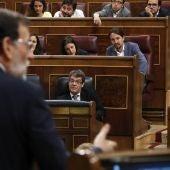 Rajoy en el Congreso con Iglesias de fondo