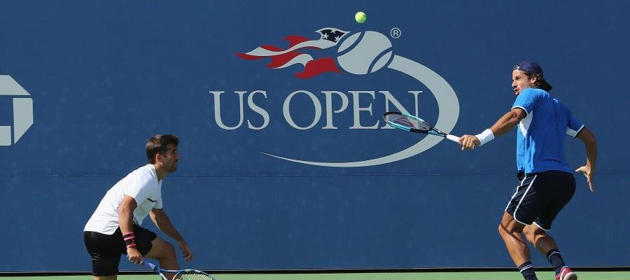 Marc López y Feliciano López, en acción durante el US Open