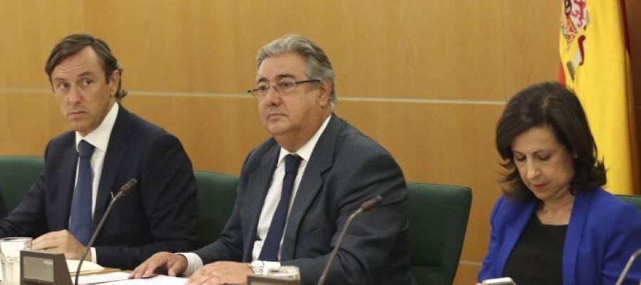 Juan Ignacio Zoido, Rafael Hernando y Margarita Robles en la reunión del Pacto Antiterrorista