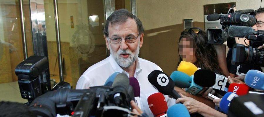El expresidente del Gobierno, Mariano Rajoy, a su llegada para incorporase en Santa Pola, a su plaza como registrador de la propiedad
