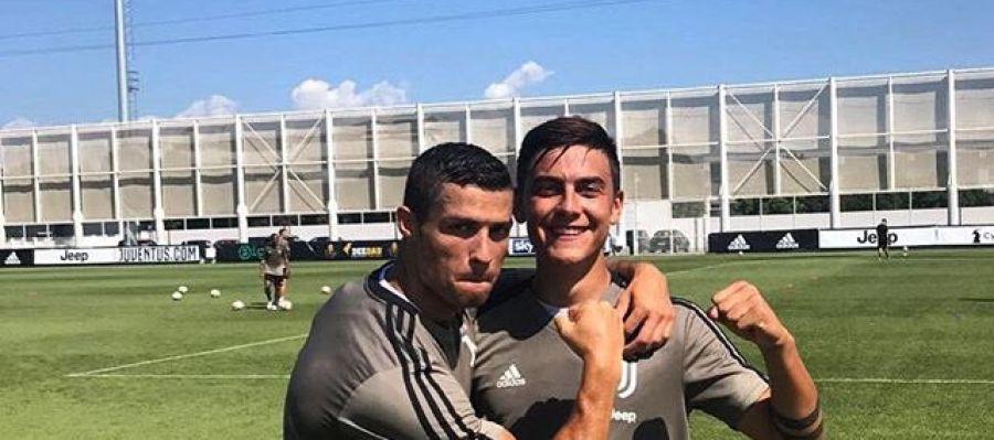 Cristiano y dybala en un entrenamiento con la Juventus