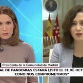 La presidenta de Madrid, Isabel Díaz Ayuso, (derecha) durante la entrevista que ofreció a Telemadrid