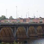 Un varón se precipita al río Guadiana desde el puente de la Universidad. Fue rescatado consciente.