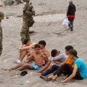 Un grupo de menores, tras cruzar la frontera de Ceuta