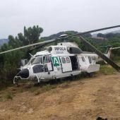 Un helicóptero del Infoca sufre un accidente, sin heridos, durante la extinción del fuego en Sierra Bermeja