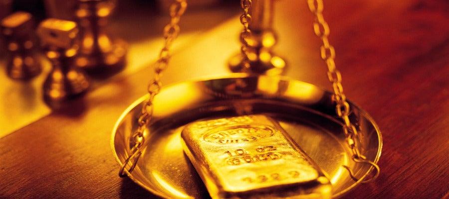 Una balanza para pesar oro