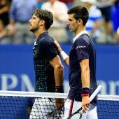 Feliciano y Djokovic se dirigen al árbitro tras terminar su partido