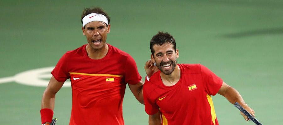 Rafa Nadal y Marc López celebran la victoria
