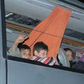 Autobuses con evacuados de ciudades sirias