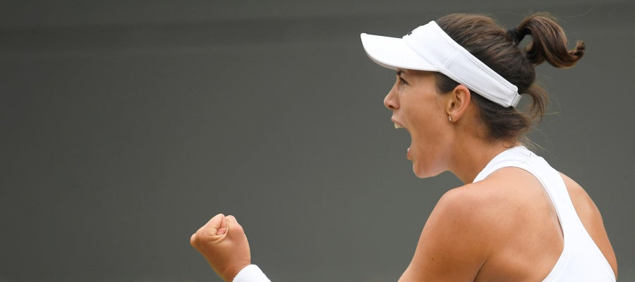 Muguruza celebra un punto ante Kuznetsova