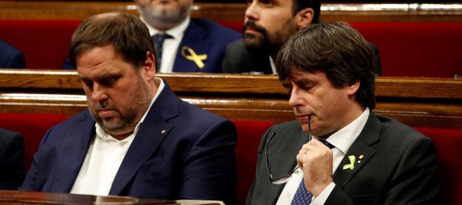 Carles Puigdemont y Oriol Junqueras