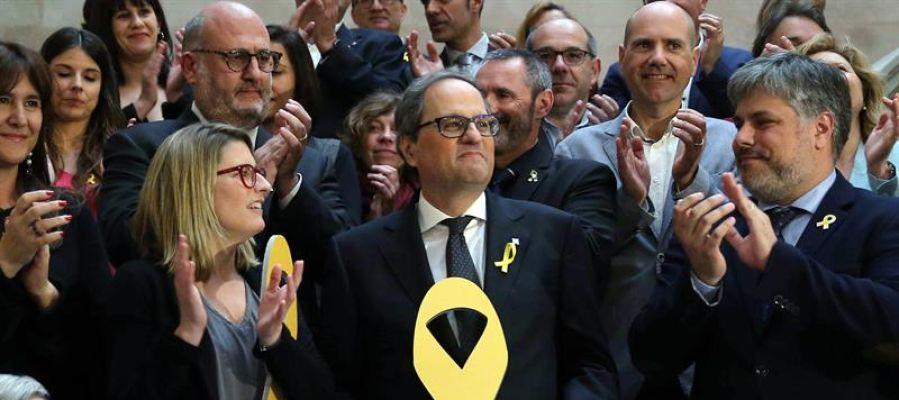 Quim Torra con un lazo amarillo
