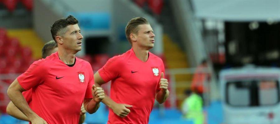 Robert Lewandowsky y Lukasz Piszczek durante un entrenamiento en Polonia