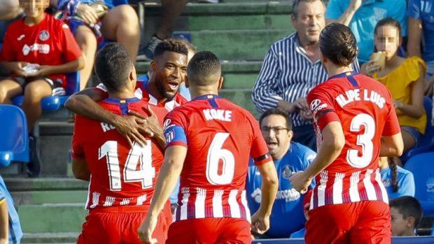 Los jugadores del Atlético de Madrid celebran un gol de Lemar