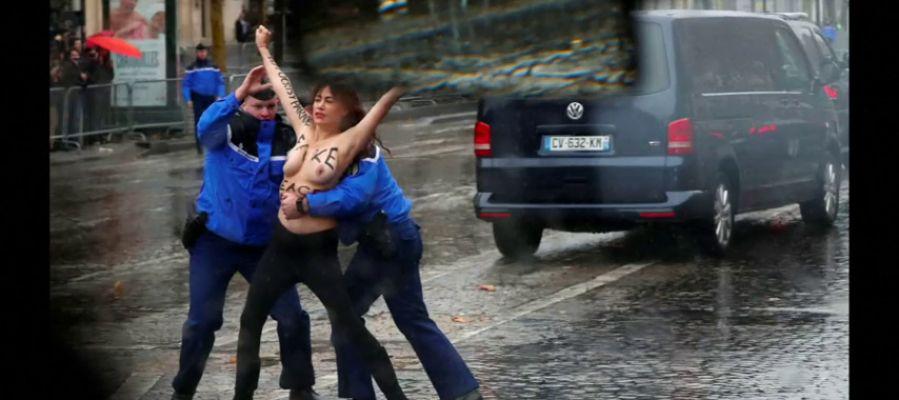 Una activista de Femen, detenida en topless antes de alcanzar la caravana de Trump en el centenario del fin de la Primera Guerra Mundial