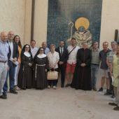 Els membres del patronat durant la visita al centrs d´interpretació de la basílica.