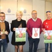 Francisco Oliva, Susi Díaz, Vicente Alberola y José Valeriano Zapata, en la presentación de la nueva imagen de la Media Maratón Internacional 'Ciudad de Elche'.
