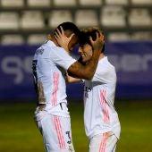 Militao y Odriozola celebran un gol del Real Madrid.
